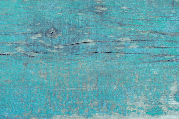 Old wooden shabby winded blue background.