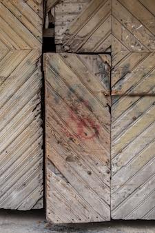 Old wooden shutters with door