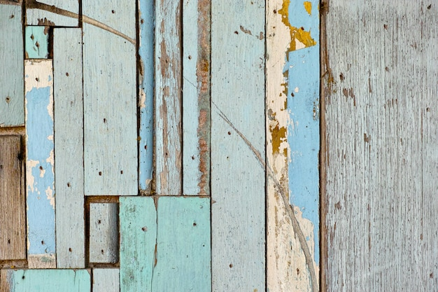 Old wooden surface, green, blue, beautifully decorated on the background of the wall