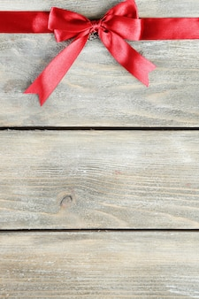 Old wooden surface with beautiful bow