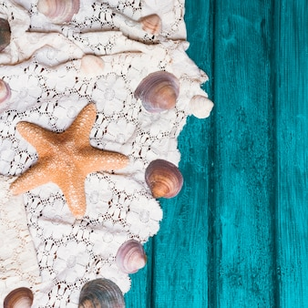 Old wooden surface with starfish and seashells