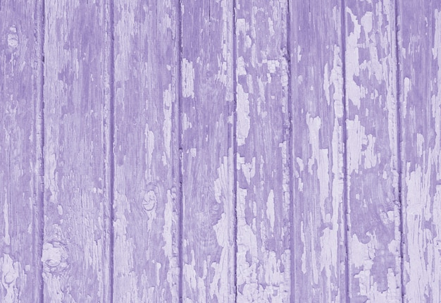 Old wooden texture toned in purple color.