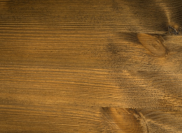 Old wooden texture top view. dark brown wood grain