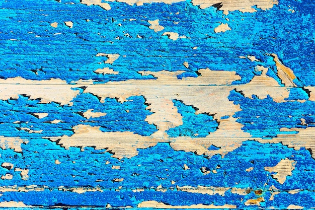 Old wooden texture with flaking blue paint, may be used as background