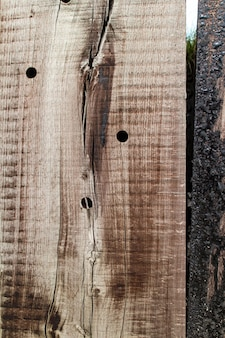 Old wooden texture with holes and cracks
