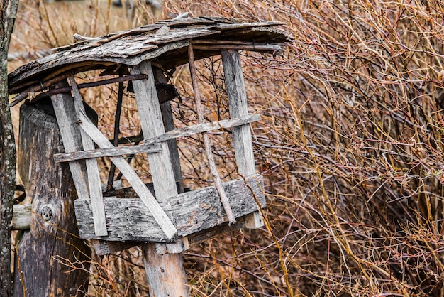 Old wooden tipical birdhouse. wintering place for birds