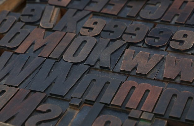 Old wooden vintage offset typography letterpress printing blocks