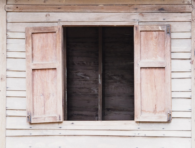 Old wooden wall see through window
