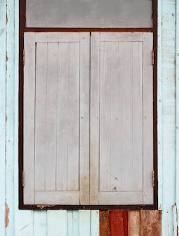 Old wooden window on wooden wall