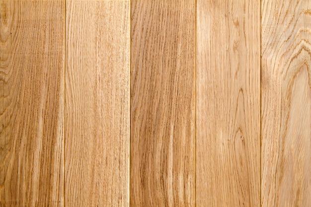 古い木製の黄色または茶色のテクスチャ背景。ボードまたはパネルの水平方向の画像
