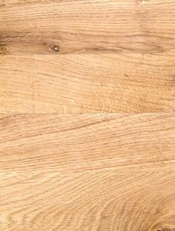 古い木製の黄色または茶色のテクスチャの背景。ボードまたはパネルの垂直方向の画像