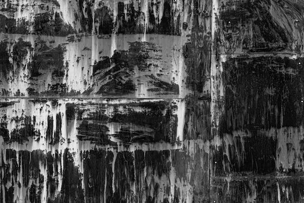 Старая изношенная структура железных вмятин и царапин на черном фоне