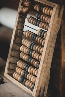Old worn out wooden abacus on a table