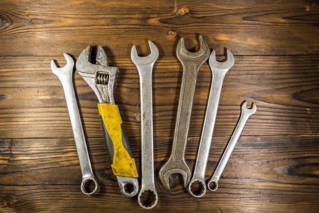 Old wrench tools on wooden background