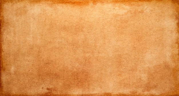 Old yellow-brown vintage paper texture, abstract grunge design background and space for text