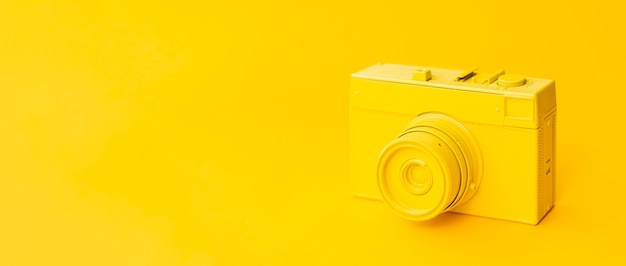 Old yellow camera with copy-space