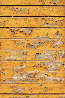 古い黄色の木製の背景抽象的な垂直背景コピースペース