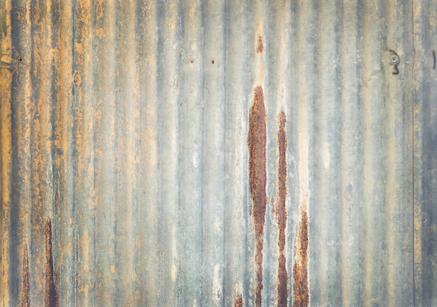 Old zinc wall texture background, rusty on galvanized metal panel sheeting.