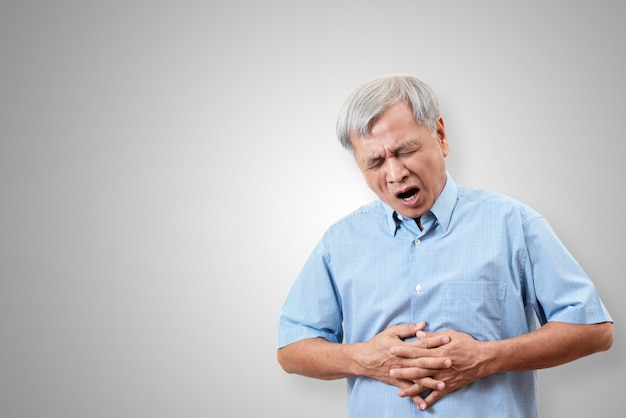 Older asian man is having stomach ache pain concept