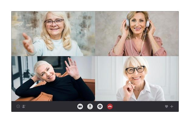Older businesswomen talking through a video call