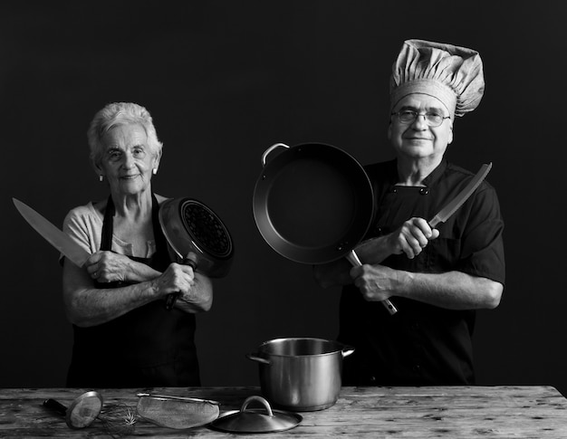 Older couple cooks