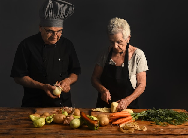 Older couple cooks