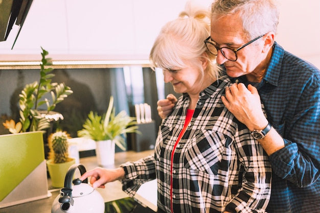 Older couple in kitchen of retirement home