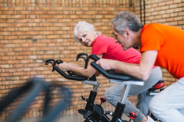 Older couple on stationery bike