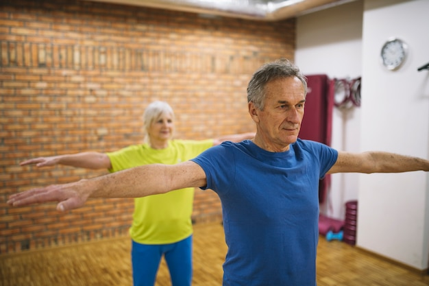 Older couple training in gym