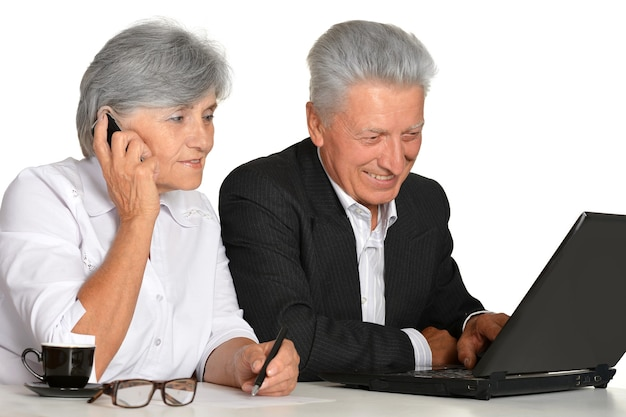 Older couple in the workplace on a white background