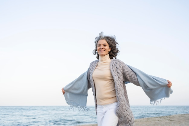 Older woman enjoying her time at the beach