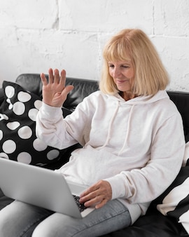 Older woman having a video call with laptop
