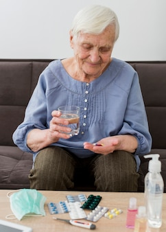 Older woman taking her daily pills