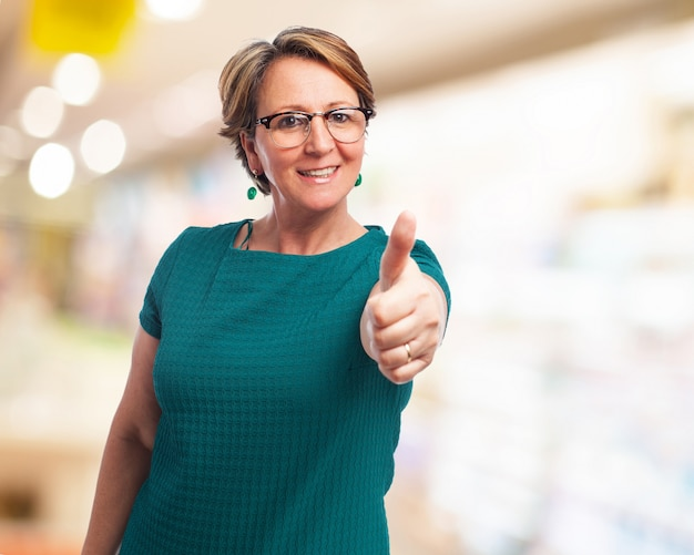 Older woman with thumb up