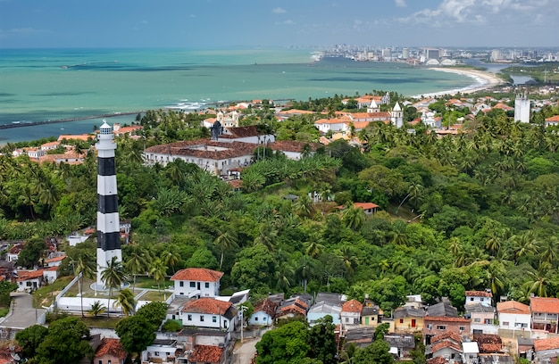 Olinda, lighthouse and the city of recife in the background, pernambuco, brazil.
