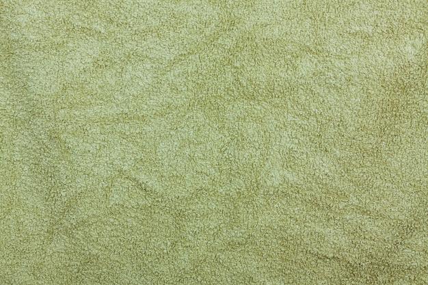 Оливково-зеленое полотенце для ванной комнаты текстильная фоновая текстура для дизайна и украшения экстремального крупным планом