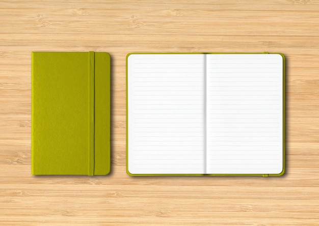 Olive green closed and open lined notebooks  isolated on wooden background