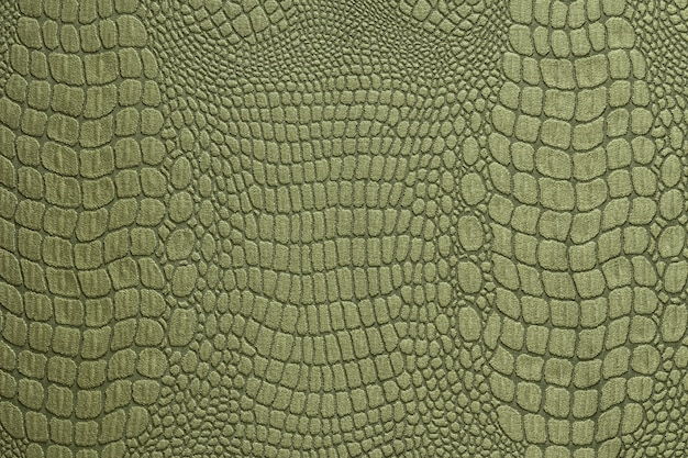 Olive green crocodile skin texture as a wallpaper