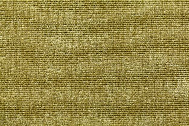 Olive green soft textile material., fabric with natural texture.