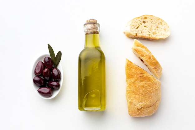 Olive oil bottle bread and purple olives