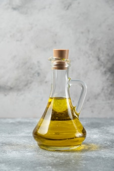 Olive oil bottle on marble table.