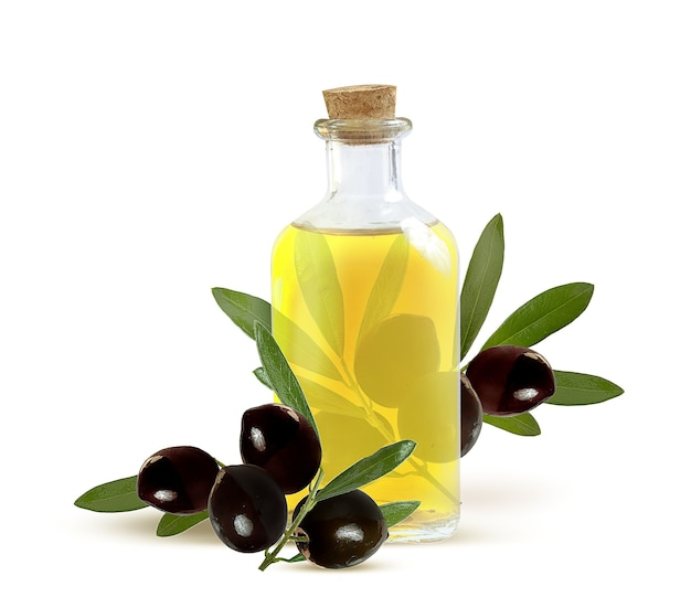 Olive oil in a glass bottle and dark olives on a branch with leaves