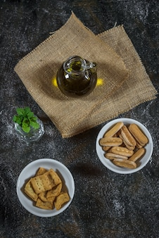 Olive oil in a glass, croutons and peppermint