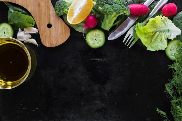Olive oil near vegetables