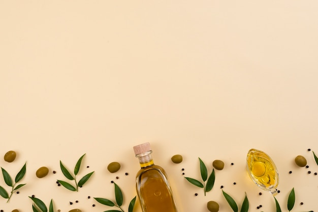 Olive oil on pink background with copy space