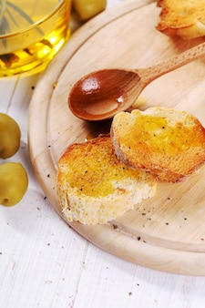 Olive oil with bread and spoon