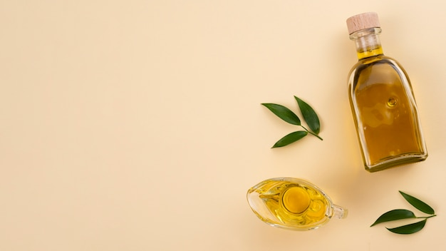 Olive oil with leaves and copy-space