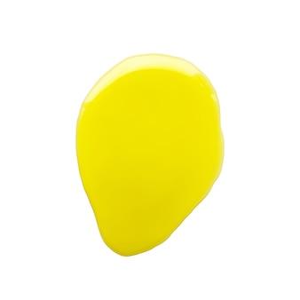 白い背景の上のオリーブオイルの黄色い斑点。