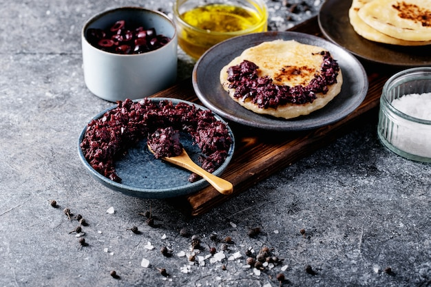Olive tapenade served with homemade bread