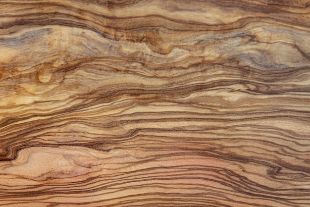 Деревянный фон оливкового дерева с коричневыми бета-версиями